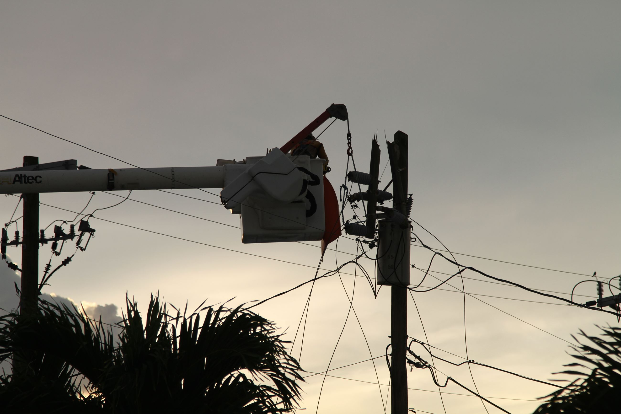 Utility Worker preparing Utility Pole for Removal (JPG)